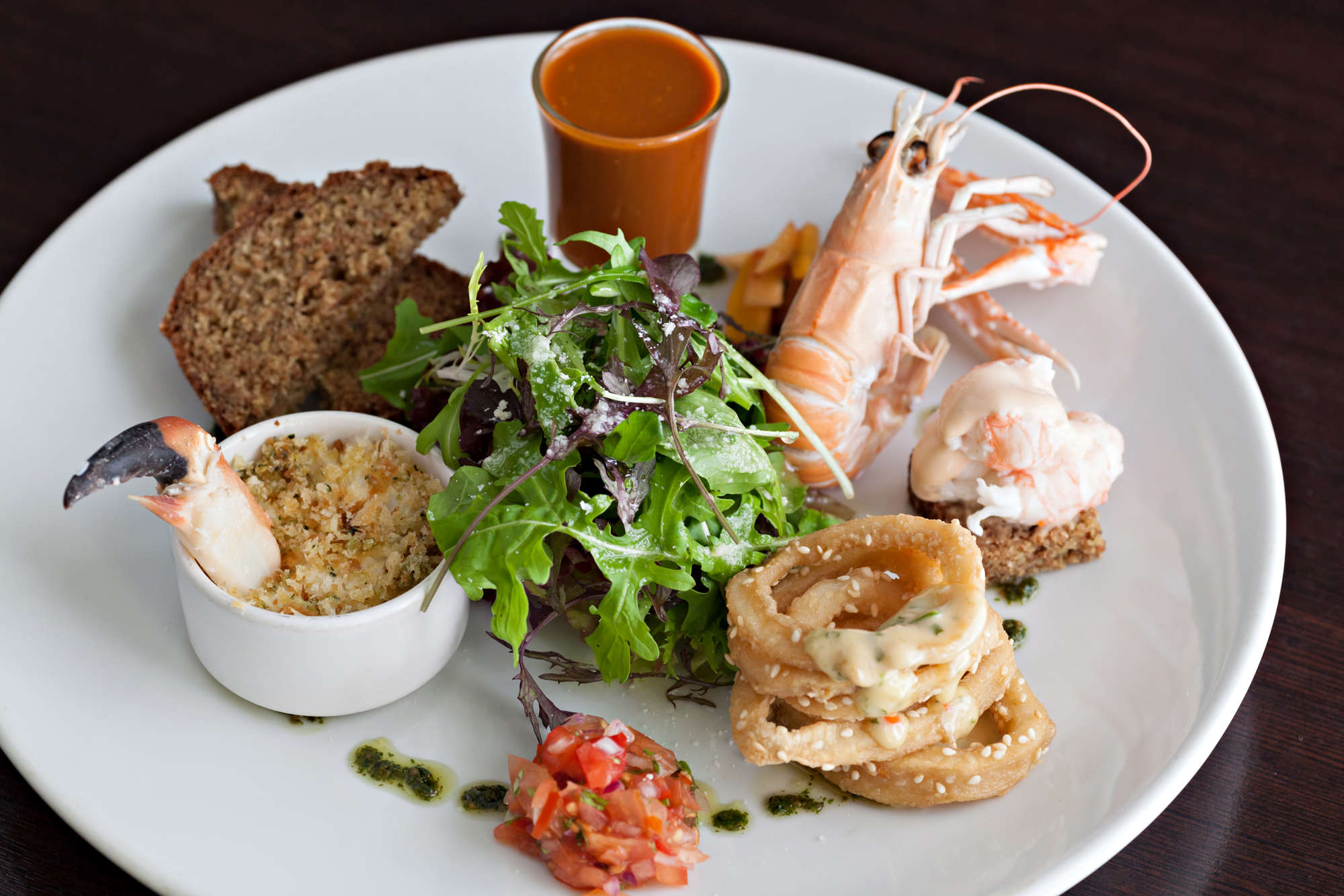 West Cork Seafood Tapas with Crab Crumble, Open Prawn, Calamari with Chilli dressing, Lobster Bisque